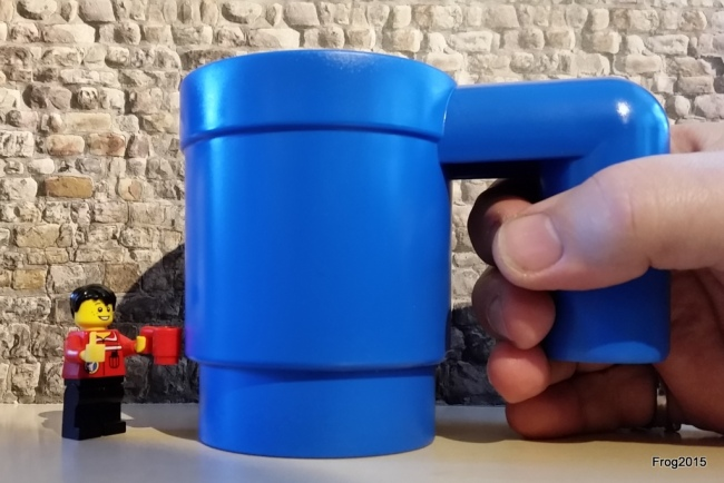 Normal LEGO mug with a normal-sized hand...